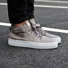 Axel Arigato grey python embossed leather sneaker with a classic design, handcrafted with premium Italian materials. #axelarigato #sneakers #mensfashion