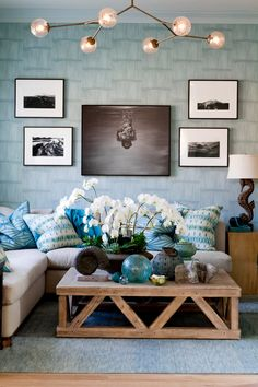Beautiful beach inspired living room in light blue tones and natural sand colors with a hint of black. Like the seahorse lamp and shell decor.