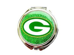 Green Bay Packers Glitter Sparkle Compact Mirror Travel Case Purse Beauty Cosmetic - GB-GL-M by aminco. $13.59. Show your team spirit with an Green Bay Packers Glitter compact mirror. The clamshell-style mirror features a full team logo on the front and opens up to reveal dual mirrors inside so you can be sure you look great on game day.