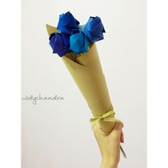 A bouquet of origami blue roses