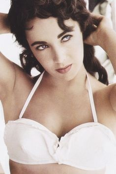 Elizabeth Taylor poses on the set of Giant; Date: 1955; photographed by Frank Worth