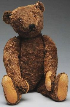 """Brown mohair with center seam face, long snout, brown glass eyes, sewn black nose and mouth, Steiff underlined Fs button in his ear; fully jointed with hump, long arms (repaired paw pads, quite a bit of fur loss on head, some on body). Very appealing face!Condition (Good). Size 15"""" T."""