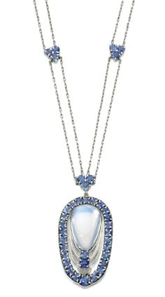 Moonstone and sapphire necklace. Louis Comfort Tiffany for Tiffany & Co, circa 1915. The open work pendant set with a cabochon moonstone within a fine twisted rope work frame, further set with circular cut sapphires, to a fine two row fetter link chain, set at intervals with trefoils of similarly cut sapphires