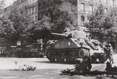 Sherman tanks of General Leclerc's 2nd French Armoured Division (note the Map-of-France emblem) in Paris on 25 August 1944.  The precise location of this 'photo is identified by the shop in the background - the Librairie Rive Gauche, on the junction of the Boulevard Saint-Michel and the Rue Vaugirard, looking across the junction in the direction of the Sorbonne.