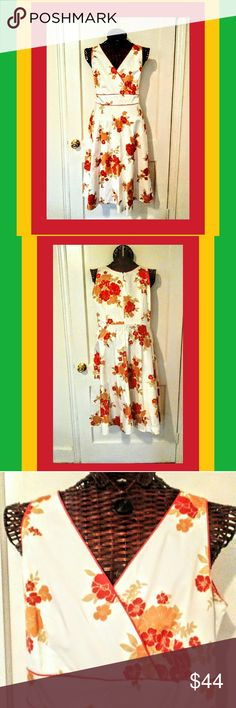 SPRING HAS SPRUNG Spring is just around the corner. Let this beautiful cream, orange, and coral dress put a spring in your step. It is fully lined with a back zipper for easy access. 97% cotton 3% Spandex. Size 16p Plaza South Petite Dresses Midi
