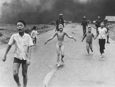 Phan Thi Kim Phuc (center) flees with other children after South Vietnamese planes mistakenly dropped napalm on South Vietnamese troops and civilians. (Nick Ut)  Date 08-06-1972   Country Vietnam   Place Trang Bang