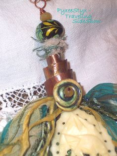 Reflections of a Wandering Yogi necklace- with hammered copper spiral bail, Ivory Elephant, and recycled sari silk tassel https://www.etsy.com/listing/170339100/reflections-of-a-wandering-yogi-tassel?ref=shop_home_active