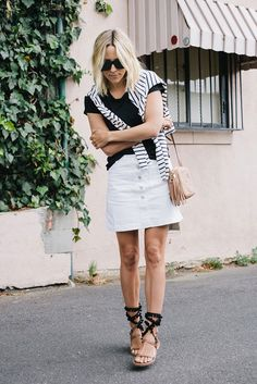 summer outfit, casual outfit, black and white outfit, beach outfit, summer vacation outfit, summer getaway outfit, street style - black t-shirt, white denim mini skirt, black and brown pom pom lace up sandals, nude shoulder bag, stripe long sleeve t-shirt, black sunglasses