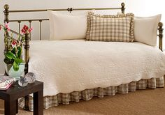 Add style and function to your guest room with this lovely five-piece day bed set by Trellis. This set is constructed of 100 percent cotton, and includes a ruffled sham, two quilted shams, one bedskirt, and one quilt, all of a pristine ivory color.