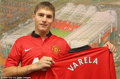 Guillermo Varela poses with the new Manchester United kit after signing his five-year deal at the club