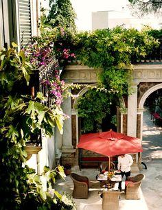 The garden courtyard of Palazzo Margherita in Bernalda, Italy.