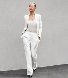 white blazer and tank top with wide leg pants