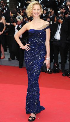 KAROLINA KURKOVA in a glittering blue Armani Privé column gown with one-shoulder detailing at the Midnight In Paris premiere in 2011. Cannes 2011.