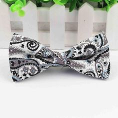 Classic, paisley, pre-tied bow ties for a classy babe. These five bow ties go REALLY well with a neutral outfit to add that POP while still keeping your overall Paisley Flower, Butterfly, Bows, Black And White, Floral, Pattern, Cotton, Smooth, Stuff To Buy