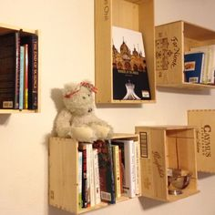 Wine box book shelves 1)drink wine 2)hang empty boxes on wall 3)collect books
