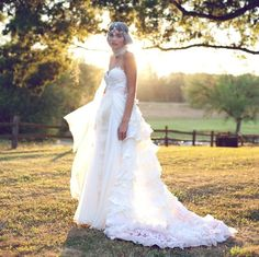 extravagant Bohemian Wedding Gown- Some Kind of Wonderful. $3,400.00, via Etsy. by Claire La Faye (It's the one with the pink layers at the bottom)