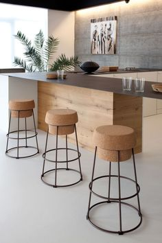 This contemporary kitchen features standout barstools from @holdithome. #luxeSoCal