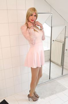 massachusettssteve:  pink set with sweatshirt and skater skirt with inverted pleats by Adri Kiss on Flickr.