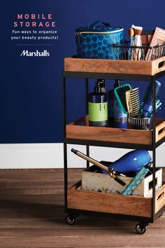 Mobile storage idea — use a bar cart to organize your beauty products! Look for industrial-inspired pieces that mix metal with rustic wood. Use wire baskets to corral makeup palettes and brushes. Plus fabric storage bins to help keep blow dryers, curling irons and straighteners in line. Add a zippered cosmetic bag for all the small essentials, and you're ready to get ready! Visit Marshalls today for fun ways to organize all your favorite products.