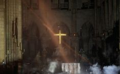 Photo shows smoke rising around the altar in front of the cross inside the Notre Dame Cathedral. REUTERS The giant white cross behind the altar also appeared to be relatively unscathed even though much of the church was reduced to rubble and ashes. Santa Bernardita, Altar, Rio Sena, Santa Sede, Paris Landmarks, Saint Chapelle, Hope Symbol, Aerial Images, Saint Louis
