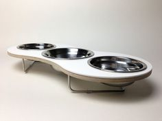 the Treo elevated pet bowl for cats and small dogs via Etsy