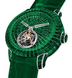 Jacob & Co a présenté au Baselworld de cette année la Caviar Emerald Tourbillon. Cette montre exclusive est ornée d'émeraudes et fut une pièce incontournable qui a attiré tous les regards lors du salon.  Pour finir, cette montre haute joaillerie possède un bracelet en alligator vert orné de 36 émeraudes et une boucle en or blanc 18 carats. La Jacob & Co Caviar Emerald Tourbillon est une pièce d'exception limitée à seulement trois exemplaires au prix de 2.450.000 dollars.