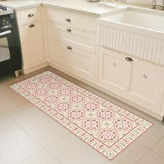 Linoleum rug printed with tiles pattern in Terra-Cotta with soft colors. Vinyl mats are durable and easy to clean, they are great for kitchens and the like. Printed with water based ink and printed to order, so custom sizes are affordable and easy to create.
