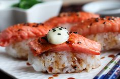 Blowtorched salmon nigiri sushi -- topped with a caramelized ginger-lime sauce, dollop of wasabi mayonnaise.