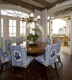 The chair fabric is great in this light pretty space with lovely arches over the french doors & a fabulous view!