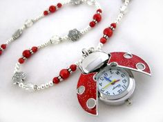 Ladybug Queen red handmade watch $23.00 - Ladies beaded necklace watch. Quartz watch pendant, red coral, and Tibet silver on tiger's tail wire.
