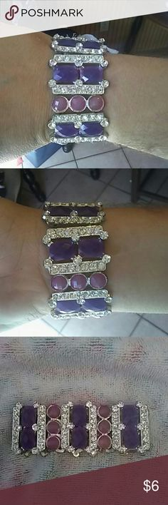 Purple & crystal jeweled stretch bracelet Very gorgeous and very sparkly stretch bracelet! It has 3 round light purple jewels, 2 square dark purple jewels all of which have a link of 7 crystals. The stretch material is in excellent condition. I rarely wore it! I bought it from Target. Target  Jewelry Bracelets
