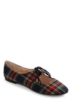 Modcloth Plaid Thai Flats  Scrumptiously stylish and with darling details you'll go nuts for, these open-vamped flats are definitely worth an order! They feature a genuine leather lining, a crisp, fabric upper, and a so-very-playful plaid print that you'll surely come to love. Slip them on, bow their front laces, and pair them with a dark apple shirtdress, tights, and a flat-lying shoulder bag for a look that's ready 'to go'!