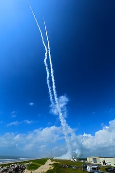 Contrails line the sky over Wallops Island, Va., on July 4, 2013 after two sounding rockets launched 15 seconds apart as part of the Daytime Dynamo experiment. A NASA Black Brant V was launched at 10:31:25 a.m. and was followed 15 seconds later by a Terrier-Improved Orion.