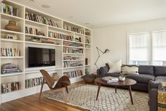 Like the idea of bookshelves covering the whole wall it makes the room appear bigger and offers extra needed storage.
