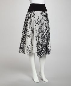 Graphic and gorgeous, this skirt boasts a modern print for standout style and a fold-over waist for hip-hugging comfort.