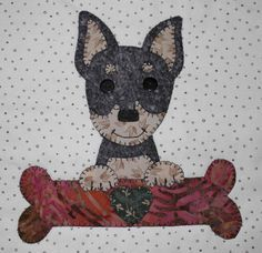 Minpin applique wall hanging.  Dog quilt.
