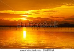 Gold sky and water at Songkhla Lake on Sunrise:Selective focus with shallow depth field. - stock photo