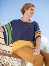 A perfect layering piece for warmer weather, this cropped coverup is trimmed with bright stripes.