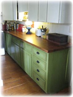 This is kinda cool - green with wood counter top and white cabinets on top (we could do wooden cabinets on top - light wood)