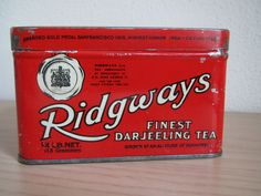 """Ridgways Finest Darjeeling Tea tin ... red rectangular chest shape w/ royal warrant and """"Tea Merchants by Appointment to H. M. King George VI and the Late Queen Victoria"""" on front and lid, c. 1930s-1950s, UK"""