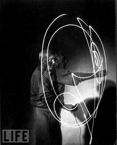 Picasso playing with a flashlight