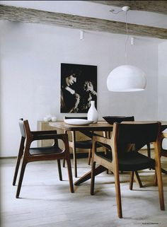 Mid century table chairs + large white pendant light