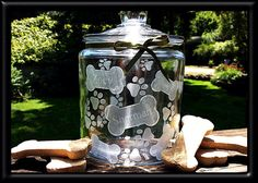 Etched Dog Treat Jar, Personalized with dog names, bones and paw prints on Etsy, $40.00