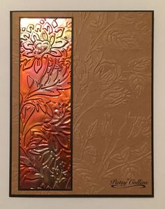 """By Patsy Collins. Cut and fold dark brown card base. Cut 5 1/2"""" x 4 1/8"""" tan cardstock: dry emboss in Cuttlebug """"Mayfair Floral"""" folder; trim to 5 3/8"""" long; attach to card front. [See Comments.] Cut 5 1/8"""" x 1 5/8"""" dark brown cardstock; attach to card at left. Heat copper sheeting with a mini butane torch until you get the colors you like; cut to 5 1/4"""" x 1 1/2""""; dry emboss in Cuttlebug """"Tropic Blooms"""" folder; trim to 5"""" long; adhere to dark brown strip. Technique from Loll Thompson."""