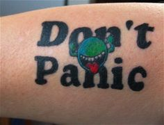 """Don't panic"" tattoo (Douglas Adams, Hitchhiker's Guide to the Galaxy)"