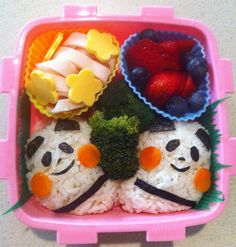 ham ribbon curls with flower cheese, strawberries and blueberries, rice pandas and broccoli.