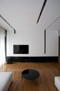 Stupendo soggiorno moderno minimal con particolare controsoffitto in cartongesso con sistema di tagli di luce per un grande impatto estetico, moderne e all'avanguardia