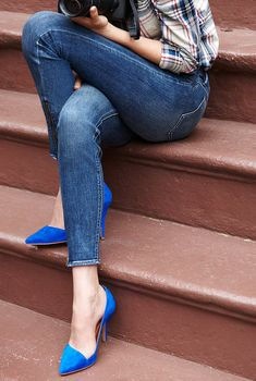 Dress up jeans and a check shirt with elegant heels.