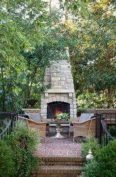 Outdoor Fireplace The property was landscaped with brick walks and patios that provide outdoor living spaces. Areas like this one by the fireplace increase opportunities for family entertaining. Outdoor Rooms, Outdoor Gardens, Outdoor Living, Outdoor Decor, Outdoor Kitchens, Outdoor Fireplace Designs, Backyard Fireplace, Outdoor Fireplaces, Tall Fireplace