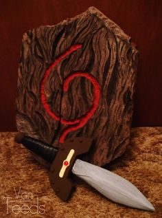 Kokiri Shield carving with wooden sword